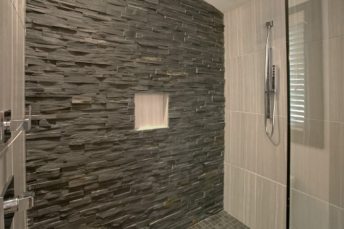 Custom Stone Shower with Multiple Shower Heads - A Castle in the Clouds