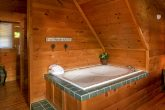 Cabin with private Jacuzzi in master suite