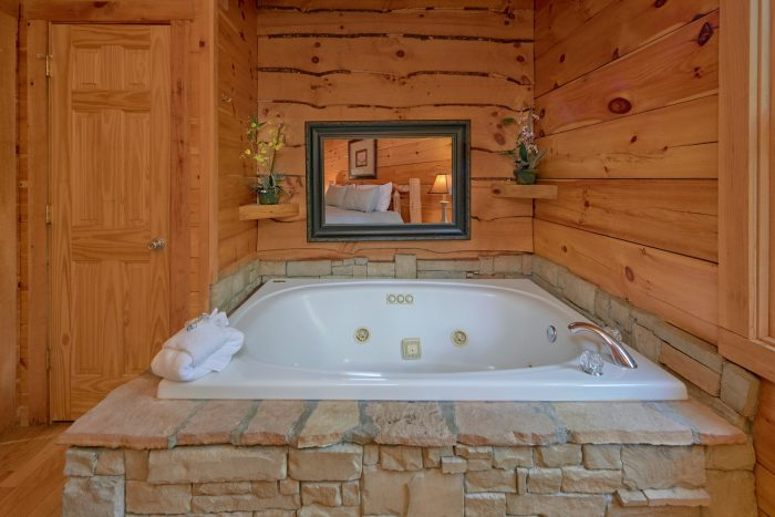 Cabin with Spacious Jacuzzi Tub - A Stones Throw