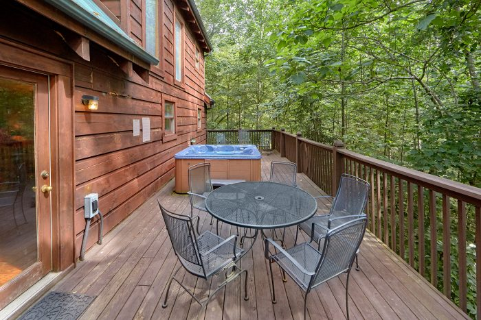 Cabin with wooded view and hot tub on deck - A Woodland Hideaway