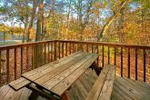 Rustic Cabin with Picnic Table and Wooded VIews