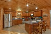 Full Kitchen with bar seating in 5 bedroom cabin