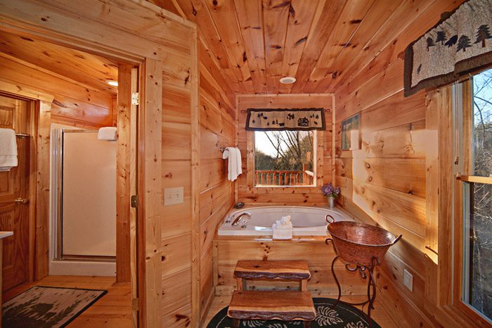Jacuzzi in Master King Suite of Cabin - Bear Footin In The Smokies