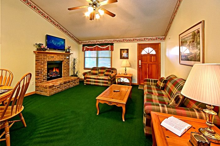 Living Room with Fireplace - Cinnamon Cottage