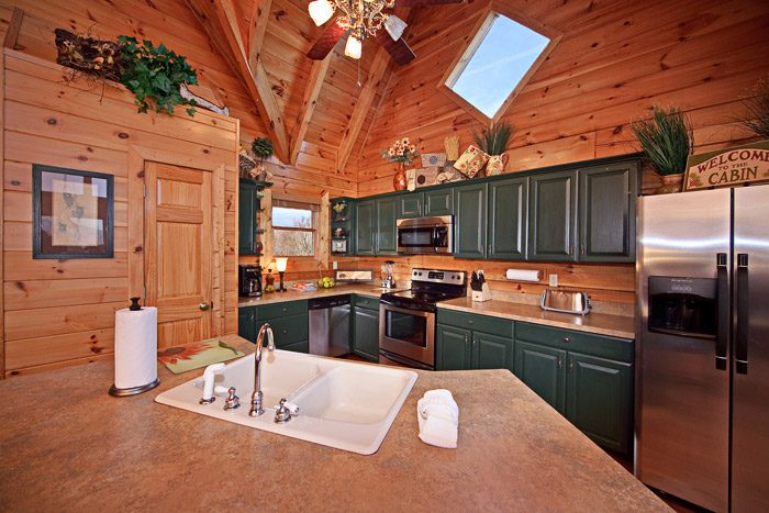 Kitchen with Stainless Steel Appliances - City View Chalet