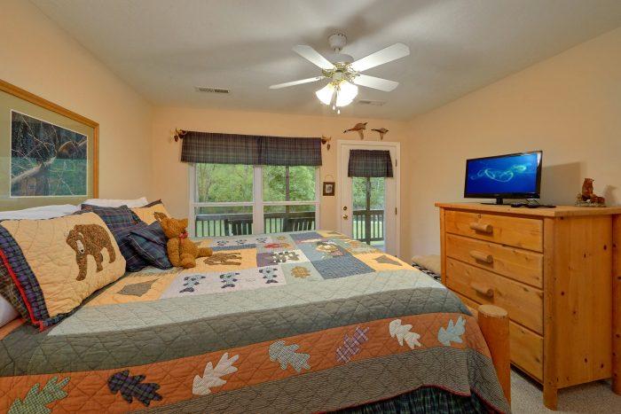 King Bedroom with private deck in cabin rental - Dancing Bears