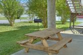 Picnic table and grill at cabin on the river
