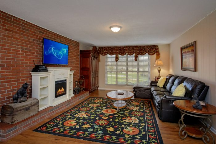 Living room with Large Fireplace and TV - Lazy Mountain Ranch
