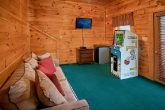 Cabin with arcade game and mini fridge