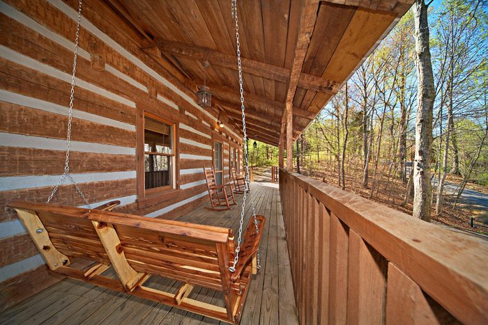Cabin with Porch Swing - Natures Heart
