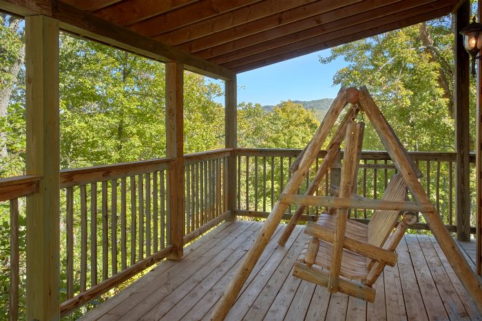 Private Cabin with Porch Swing on Deck - Natures Majesty