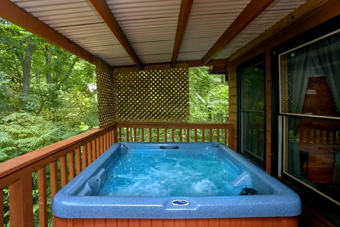 Smoky mountain honeymoon cabin rental heart shaped for Cabin in gatlinburg with hot tub
