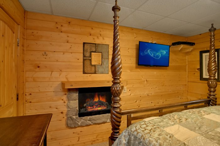 King Bedroom with Fireplace and TV - Scenic Mountain Pool
