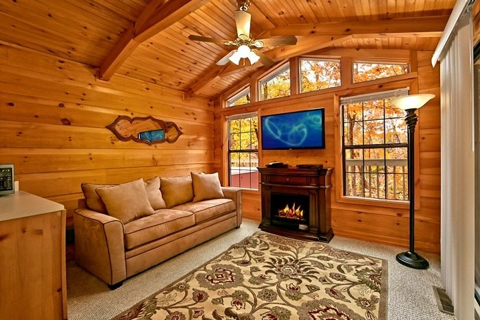 cabin with sleeper sofa and fireplace secret rendezvous