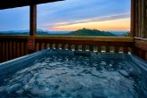 Cabin with hot tub and private mountain view